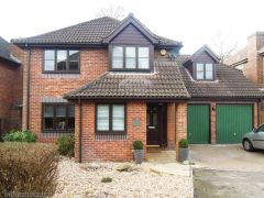Replace fascia and soffits with UPVC in rosewood and brown square guttering