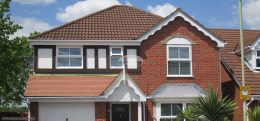 Decorative fascia with white square guttering
