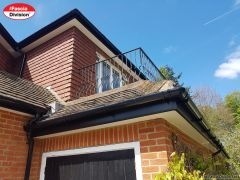 UPVC black ash fascia, white plain soffit with black deep round guttering installation
