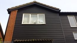 Hardieplank cladding with UPVC black ash fascias soffits