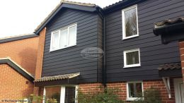 Midnight black hardieplank cladding with black ash fascias soffits