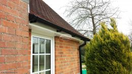 Black deep round guttering with white fascia and soffit