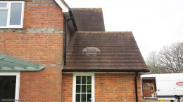 Installation of white UPVC fascia and soffit with black UPVC guttering