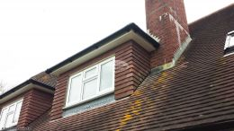 White UPVC fascia, soffit with black gutters on dorma windows