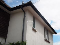 Installation of UPVC plain soffit with black fascia and guttering in Wimborne
