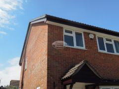 New rosewood UPVC fascias with white UPVC soffit Bournemouth