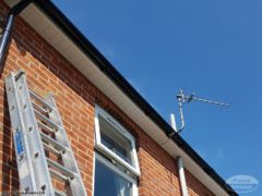 New UPVC white soffits and fascias with black gutters